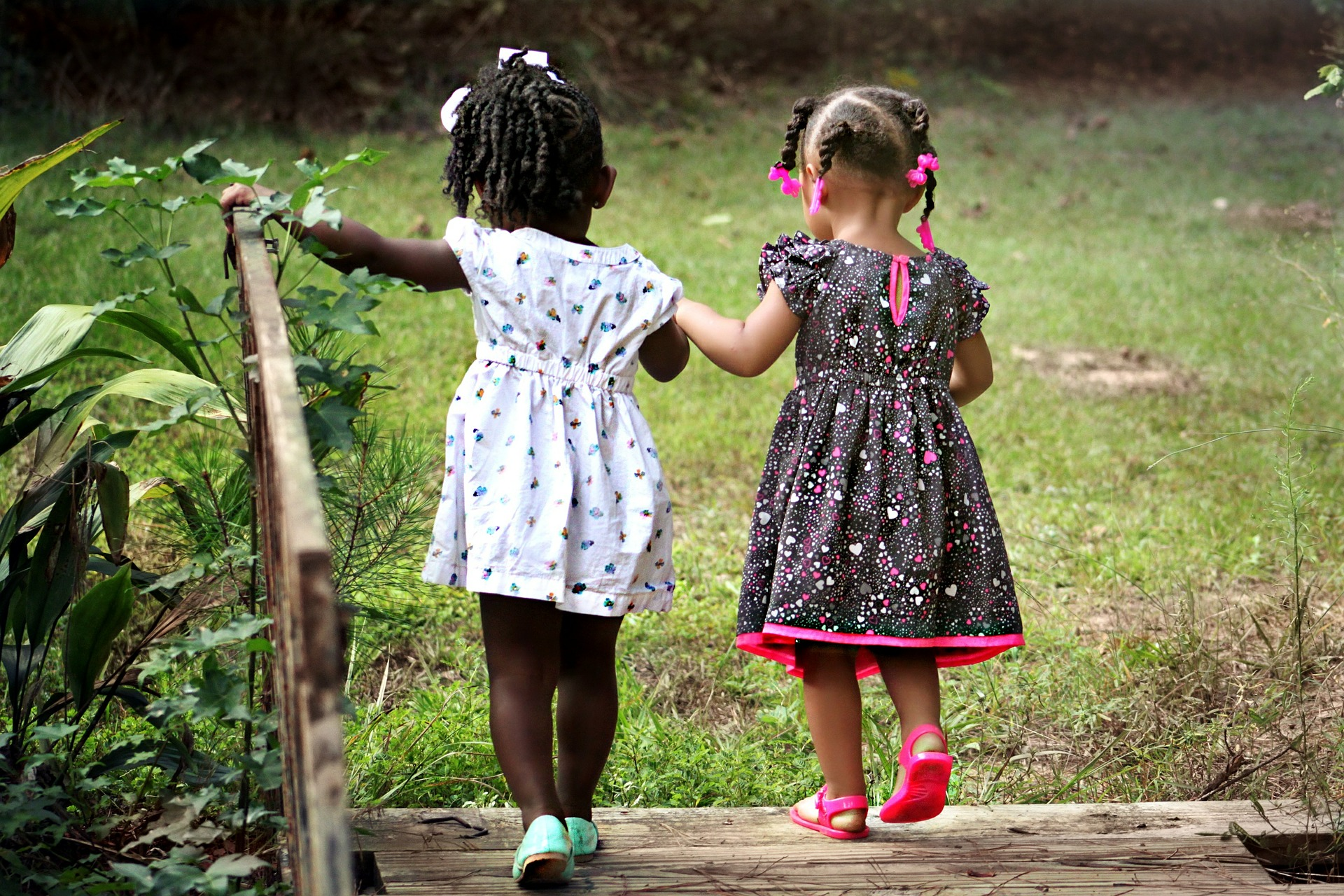 Two girls playing on a bridge at holiday club